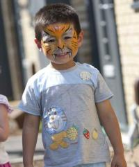 Boy with face painted as a tiger