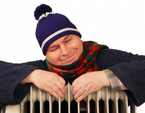 Man hugging Radiator Winter Warm