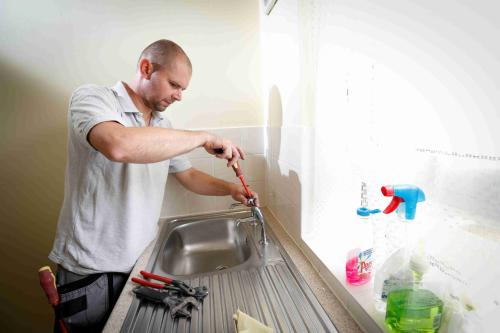 Repairs Man working Sink